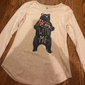 a long sleeved shirt with a pink and navy bear
